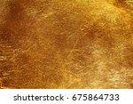 golden background texture. | Shutterstock . vector #675864733