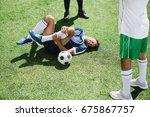 injured soccer player lying on... | Shutterstock . vector #675867757