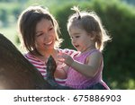 mother and little daughter... | Shutterstock . vector #675886903