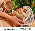 mud facial mask of woman in spa ... | Shutterstock . vector #676006213