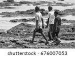 african children walk on ocean... | Shutterstock . vector #676007053