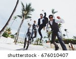 happy groom and groomsmen jump... | Shutterstock . vector #676010407