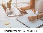 a business woman working on the ... | Shutterstock . vector #676031347