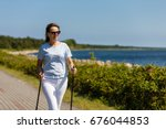 nordic walking   middle aged... | Shutterstock . vector #676044853