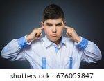 closeup portrait of worried boy ...   Shutterstock . vector #676059847