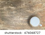 mock up hot coffee on wooden... | Shutterstock . vector #676068727