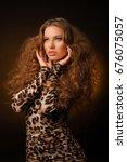 girl in leopard dress and black ... | Shutterstock . vector #676075057