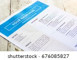 Small photo of Template of resume on white paper with blue theme. Focus on experience title and blurred other titles.