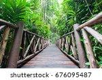 the bridge in the jungle. green ... | Shutterstock . vector #676095487