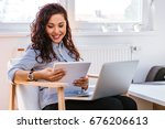 beautiful girl studying online... | Shutterstock . vector #676206613