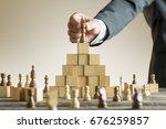 businessman placing a chess... | Shutterstock . vector #676259857