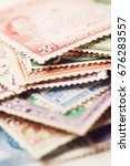 pile of postage stamps | Shutterstock . vector #676283557