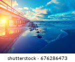 pier and sea at sunset | Shutterstock . vector #676286473