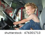 a little boy with blonde curly... | Shutterstock . vector #676301713
