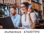 buying her first stock. | Shutterstock . vector #676307593