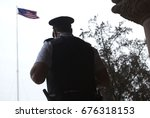 police officer   guard in front ... | Shutterstock . vector #676318153