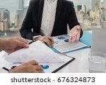 businessmen are analyzing... | Shutterstock . vector #676324873
