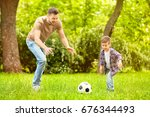 dad and son playing football... | Shutterstock . vector #676344493