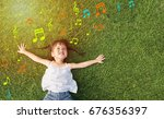 asian little girl smile and lay ... | Shutterstock . vector #676356397