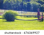 boy standing by the wooden... | Shutterstock . vector #676369927