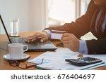 businessman using laptop and... | Shutterstock . vector #676404697