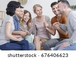 small support group praying... | Shutterstock . vector #676406623