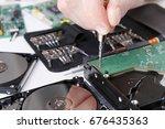 electronics repair concept.... | Shutterstock . vector #676435363