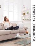 happy girl talking on mobile... | Shutterstock . vector #676436383