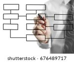 hand drawing chart on whiteboard | Shutterstock . vector #676489717
