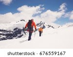 rear view of two hikers joined... | Shutterstock . vector #676559167