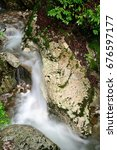Small photo of Small mountain creek with waterfall at the Abkhazian forest, Kodori gorge