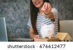 happy woman saving money in a... | Shutterstock . vector #676612477