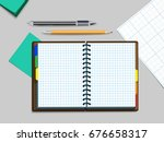 notebook with a pen and pencil.