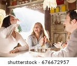 friends laughing in ski lodge...   Shutterstock . vector #676672957
