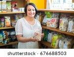 positive mature female customer ... | Shutterstock . vector #676688503