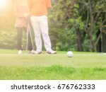 Small photo of golf ball on green golf and golfer and caddy or caddie