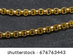 Gold Necklace Placed On A Blac...