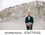 the groom with a bouquet of... | Shutterstock . vector #676779103