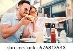 dating in pizzeria. handsome... | Shutterstock . vector #676818943