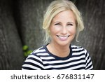 mature woman smiling at the... | Shutterstock . vector #676831147