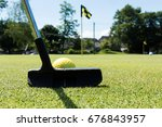 a black putter is about to hit...   Shutterstock . vector #676843957