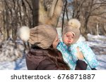 mother and child playing in the ... | Shutterstock . vector #676871887