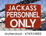 Small photo of Humorous admittance sign.