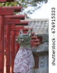 Small photo of Fox Stature in Japanese Shrine