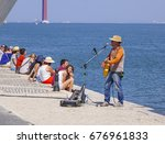 relaxing at the banks of tagus... | Shutterstock . vector #676961833