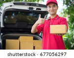 asian postman in blue uniform... | Shutterstock . vector #677056297