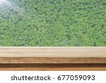 wood table top on blur abstract ...   Shutterstock . vector #677059093