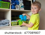 the child puts his clothes on.... | Shutterstock . vector #677089807