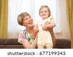 senior woman hold little baby... | Shutterstock . vector #677199343