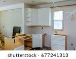 installation of kitchen... | Shutterstock . vector #677241313